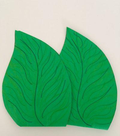 La foglia, simbolo del Premio GreenCare, disegnata dagli alunni del II Circolo Didattico Giancarlo Siani di Mugnano